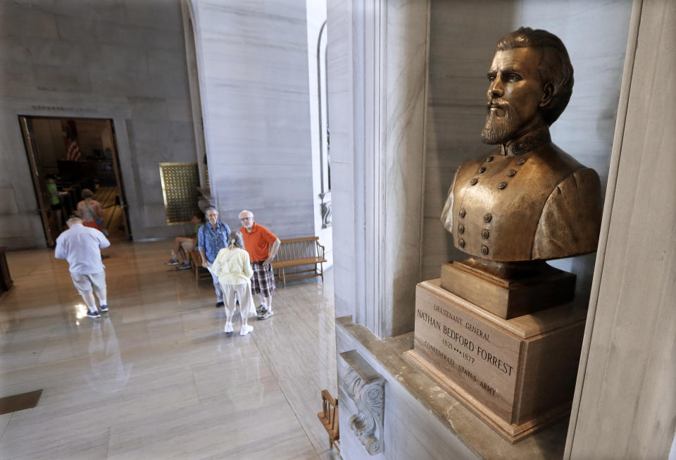 FILE In this Aug. 17, 2017 file photo, a bust of Nathan Bedford Forrest is displayed in the Tennessee State Capitol, in Nashville, Tenn. Two African-American activists were arrested Thursday, Feb. 28, 2019, the final day of Black History Month, while demanding lawmakers remove the bust from the state Capitol of Confederate Gen. Forrest, an early Ku Klux Klan leader. (AP Photo/Mark Humphrey, File)