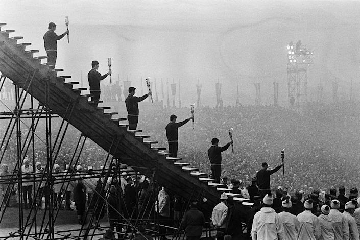 <p>The 1968 Winter Olympics opening ceremony included incredible details, such as 500 tiny Olympic flags on paper parachutes and 30,000 perfumed faux roses descending into the audience. Perhaps the most dramatic touch of all, though, was when French athletes carried the Olympic torch. The final torch-bearer, figure skater Alain Calmat, ascended the stairs to light the flame while the sound of his heartbeat was amplified throughout the quiet stadium.</p>