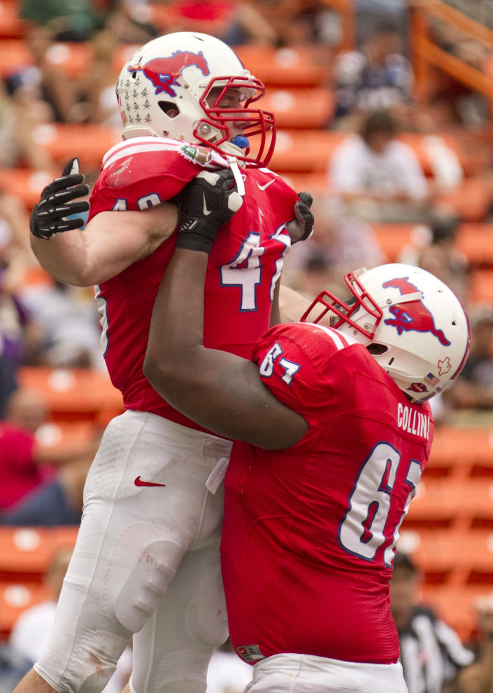 SMU offensive linesman Bryan Collins (67) picks up running back Zach Line (48) in celebration after Line scored a touchdown against Hawaii in the second quarter of the Hawaii Bowl, an NCAA college football game Monday, Dec. 24, 2012, in Honolulu. (AP Photo/Eugene Tanner)