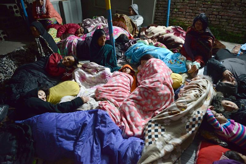 Nepalese residents sleep in an open area in Kathmandu on April 26, 2015, after an earthquake (AFP Photo/Prakash Mathema)