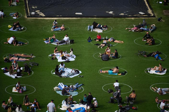 People practice social distancing in white circles in Domino Park in the Williamsburg section of Brooklyn, May 17. (Noam Galai/Getty Images)