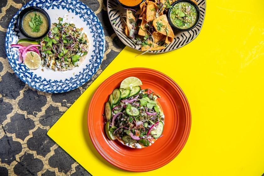 """Rajas taco, chips and salsa and ceviche from Masataco. <span class=""""copyright"""">(Mariah Tauger / Los Angeles Times)</span>"""