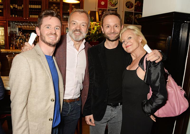 "LONDON, ENGLAND - MAY 25: (L to R) Guest, Graham Norton, Jeremy Langmead and Maria McErlane attend the press night after party for The Kenneth Branagh Theatre Company's ""Romeo And Juliet"" at The The National Cafe on May 25, 2016 in London, England. (Photo by David M. Benett/Dave Benett/Getty Images)"