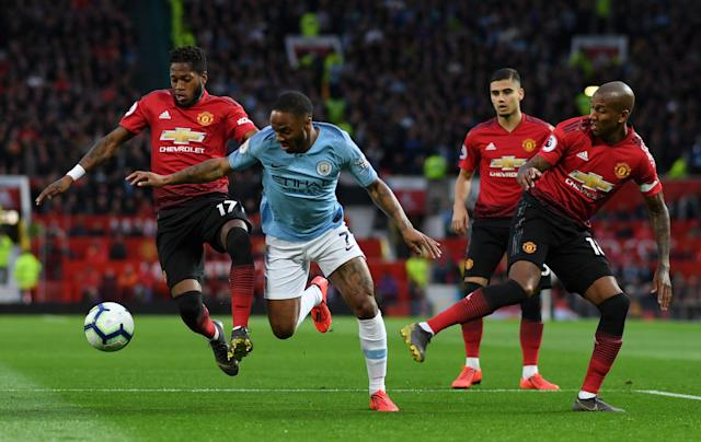 Fred and Ashley Young of Manchester United battle for possession with Raheem Sterling of Manchester City during the Premier League match between Manchester United and Manchester City