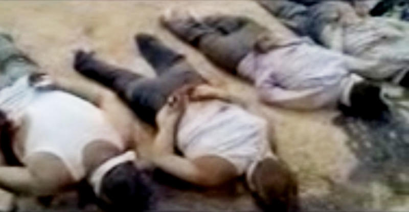 In this image made from amateur video released by the Shaam News Network and accessed Tuesday, May 29, 2012, purports to show 13 blindfolded and handcuffed bodies on the ground in Deir el-Zour, Syria. U.N. observers have discovered 13 bound corpses in eastern Syria, many of them apparently shot execution-style, the monitoring mission said Wednesday. (AP Photo/Shaam News Network via AP video) TV OUT, THE ASSOCIATED PRESS CANNOT INDEPENDENTLY VERIFY THE CONTENT, DATE, LOCATION OR AUTHENTICITY OF THIS MATERIAL