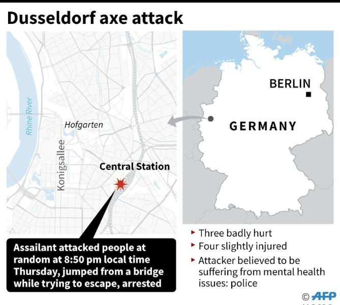 Special police commandos arrive at the main train station in Duesseldorf, western Germany, late on March 9, 2017 after at least nine people where injured by a man with an axe