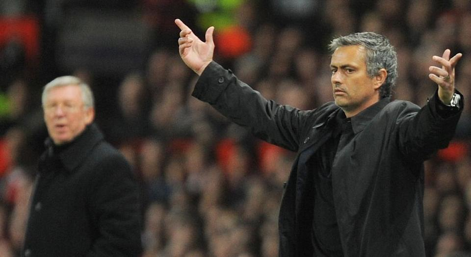 Inter Milan's head coach Jose Mourinho (R) gestures next to Manchester United manager Sir Alex Ferguson during a UEFA Champions League match at Old Trafford in Manchester, in March 2009 (AFP Photo/ANDREW YATES)