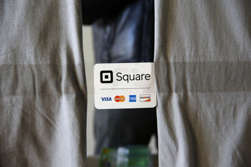 An advertisement for the Square payment processor is seen outside a vendors site along the High Line in New York