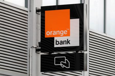 FILE PHOTO: The logo of cash machines Orange Bank is seen on the facade of the Bank headquarters in Montreuil near Paris