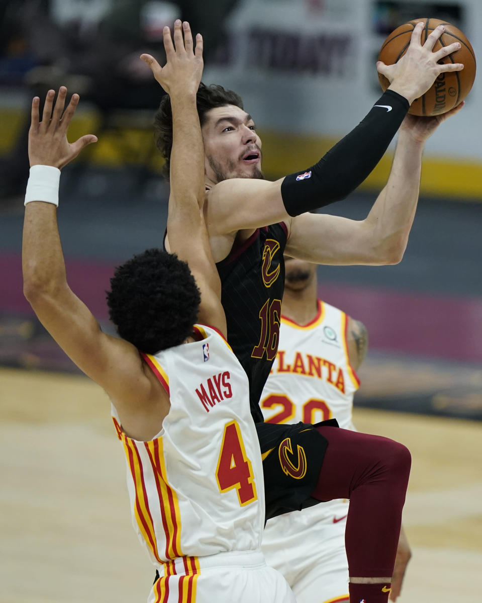 Cleveland Cavaliers' Cedi Osman (16) drives to the basket against Atlanta Hawks' Skylar Mays (4) in the first half of an NBA basketball game, Tuesday, Feb. 23, 2021, in Cleveland. (AP Photo/Tony Dejak)