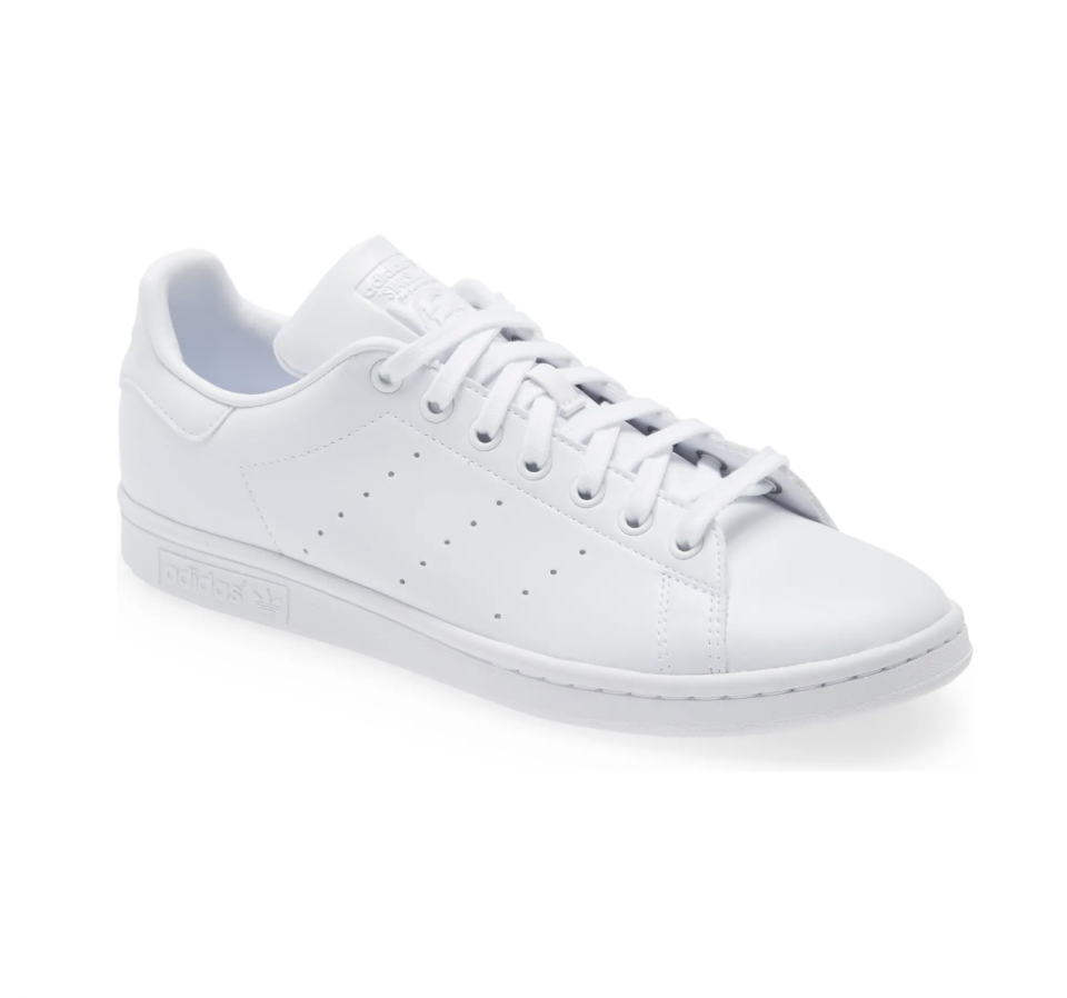 """<p><strong>Adidas</strong></p><p>nordstrom.com</p><p><strong>$85.00</strong></p><p><a href=""""https://go.redirectingat.com?id=74968X1596630&url=https%3A%2F%2Fwww.nordstrom.com%2Fs%2Fadidas-stan-smith-low-top-sneaker-men%2F5740450&sref=https%3A%2F%2Fwww.esquire.com%2Fstyle%2Fmens-fashion%2Fg28186249%2Fbusiness-casual-shoes%2F"""" rel=""""nofollow noopener"""" target=""""_blank"""" data-ylk=""""slk:Shop Now"""" class=""""link rapid-noclick-resp"""">Shop Now</a></p><p>The white sneaker: Adidas and Stan Smith certainly did it well. If you have a <a href=""""https://www.esquire.com/style/mens-fashion/news/a48565/j-crew-ludlow-martin-greenfield/"""" rel=""""nofollow noopener"""" target=""""_blank"""" data-ylk=""""slk:Ludlow suit"""" class=""""link rapid-noclick-resp"""">Ludlow suit</a> or something similar hanging around, pair it with this veritable icon. </p>"""