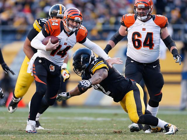 PITTSBURGH, PA - DECEMBER 23: Andy Dalton #14 of the Cincinnati Bengals tries to get around the tackle of James Harrison #92 of the Pittsburgh Steelers during the fourth quarter at Heinz Field on December 23, 2012 in Pittsburgh, Pennsylvania. Cincinnati won the game 13-10. (Photo by Gregory Shamus/Getty Images)