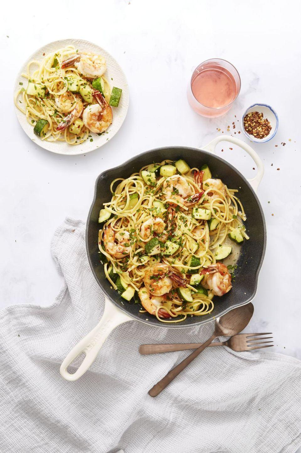 """<p>Pasta dinners don't have always feel heavy. Don't believe us? Just try this light scampi with white wine sauce.<br></p><p><em><a href=""""https://www.goodhousekeeping.com/food-recipes/easy/a34146/shrimp-and-zucchini-scampi/"""" rel=""""nofollow noopener"""" target=""""_blank"""" data-ylk=""""slk:Get the recipe for Shrimp and Zucchini Scampi »"""" class=""""link rapid-noclick-resp"""">Get the recipe for Shrimp and Zucchini Scampi »</a></em></p>"""