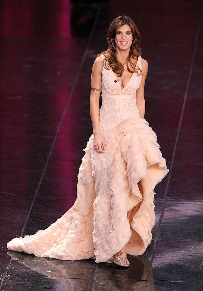 """George Clooney's Italian gal pal, model/actress Elisabetta Canalis, dropped jaws upon hitting the stage at the 61st Sanremo Festival in a custom-made, flamenco-style Roberto Cavalli gown, and bejeweled sandals. Venturelli/<a href=""""http://www.wireimage.com"""" target=""""new"""">WireImage.com</a> - February 17, 2011"""