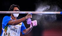 <p>India coach Lahkan Sharma sprays down the bars during a training session at the Ariake Gymnastics Arena ahead of the start of the 2020 Tokyo Summer Olympic Games in Tokyo, Japan. (Photo By Ramsey Cardy/Sportsfile via Getty Images)</p>