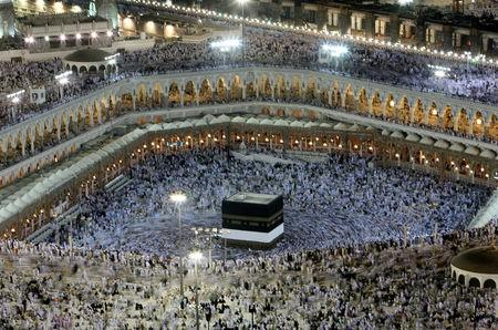 FILE PHOTO: Muslims circle the Kaaba inside the Grand Mosque in Mecca December 13, 2007. REUTERS/Ali Jarekji/File Photo