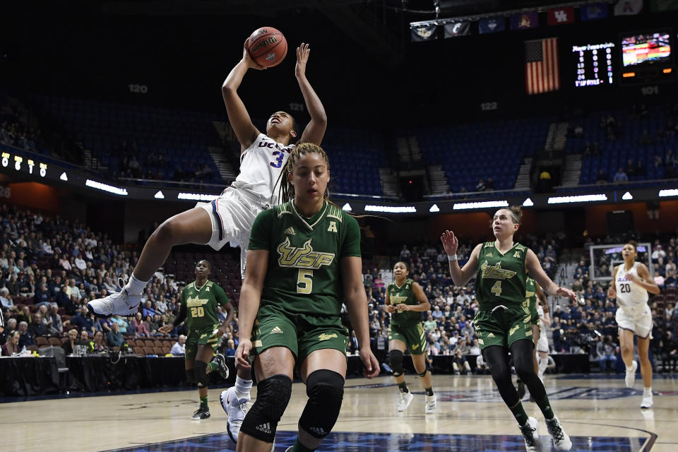 Connecticut's Megan Walker (3) goes up for a basket against South Florida during the first half of an NCAA college basketball game in the American Athletic Conference tournament seminfals at Mohegan Sun Arena, Sunday, March 8, 2020, in Uncasville, Conn. (AP Photo/Jessica Hill)