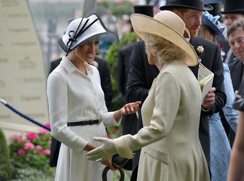 ASCOT, ENGLAND - JUNE 19: (L-R) Meghan Duchess of Sussex, Camilla Duchess of Cornwall and Prince Harry, Duke of Sussex arrive on day 1 of Royal Ascot at Ascot Racecourse on June 19, 2018 in Ascot, England. (Photo by Kirstin Sinclair/Getty Images for Ascot Racecourse)
