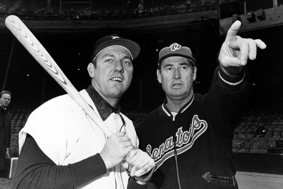 FILE - In this April 30, 1969, file photo, Detroit Tigers' Al Kaline has a baseball bat shouldered as he shares a moment with Washington Senators manager Ted Williams, in Detroit. (AP Photo/File)