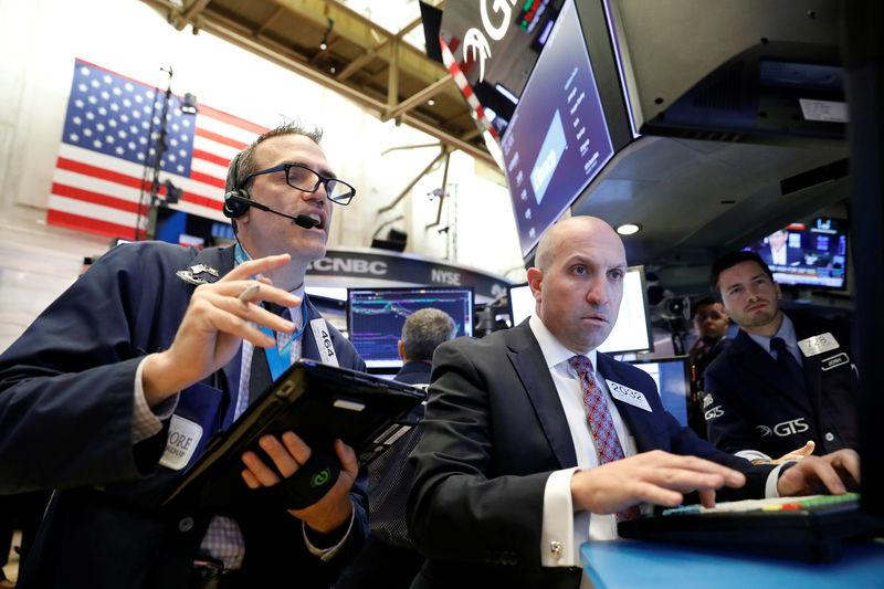 Traders work on the floor of the New York Stock Exchange in New York