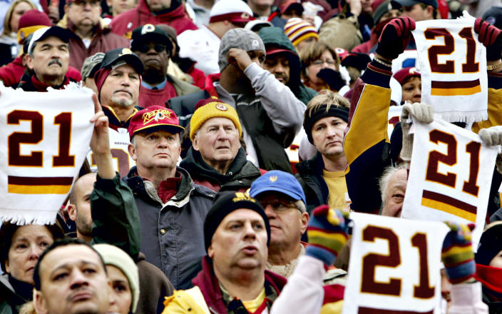 FILE - In this Dec. 2, 2007, file photo, solemn football fans hold up towels with No. 21 in memory of slain Washington Redskins safety Sean Taylor during a ceremony before an NFL football game against the Buffalo Bills at FedExField in Landover, Md. The Washington Football Team plans to retire late safety Sean Taylor's number before its upcoming game against Kansas City. (AP Photo/J. Scott Applewhite, File)