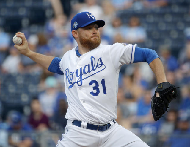 Kansas City Royals starting pitcher Ian Kennedy throws during the first inning of a baseball game against the Tampa Bay Rays Tuesday, May 15, 2018, in Kansas City, Mo. (AP Photo/Charlie Riedel)