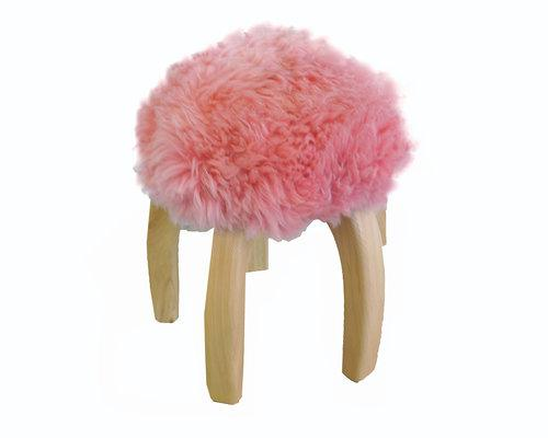 "Pink Sheepskin Stool, $325; at <a rel=""nofollow"" href=""http://www.clic.com/furniture/pink-sheepskin-stool-1"">Clic Gallery</a>"