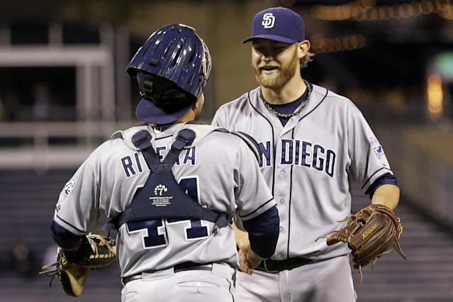 San Diego Padres starting pitcher Andrew Cashner, right, celebrates with catcher Rene Rivera (44) after getting the final out of a baseball game against the Pittsburgh Pirates in Pittsburgh Monday, Sept. 16, 2013. Cashner threw a complete-game one-hitter in the 2-0, Padres win. AP Photo/Gene J. Puskar)