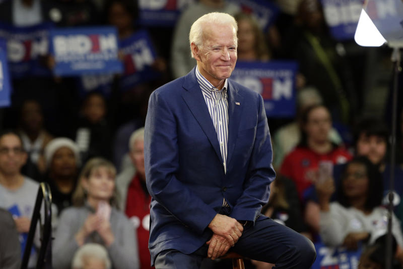 FILE - In this Feb. 29, 2020, file photo Democratic presidential candidate former Vice President Joe Biden smiles at supporters during a campaign event at Saint Augustine's University in Raleigh, N.C. Biden has won the last few delegates he needed to clinch the Democratic nomination for president. (AP Photo/Gerry Broome, File)