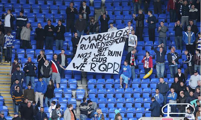 Fans just about fit the letters on a banner to deliver a message to Mark Hughes after QPR were relegated together with Reading in the same match in 2013.