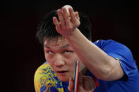 Fan Zhendong of China eyes the ball during a gold medal match of the table tennis men's singles against Ma Long of China at the 2020 Summer Olympics, Friday, July 30, 2021, in Tokyo. (AP Photo/Kin Cheung)