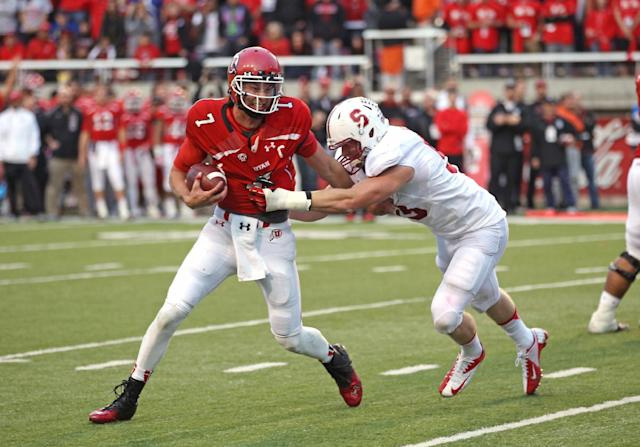 Utah quarterback Travis Wilson (7) attempts to break a tackle from Stanford linebacker Trent Murphy, right, during the second half of an NCAA college football game on Saturday, Oct. 12, 2013, in Salt Lake City. Utah won 27-21. (AP Photo/Rick Bowmer)