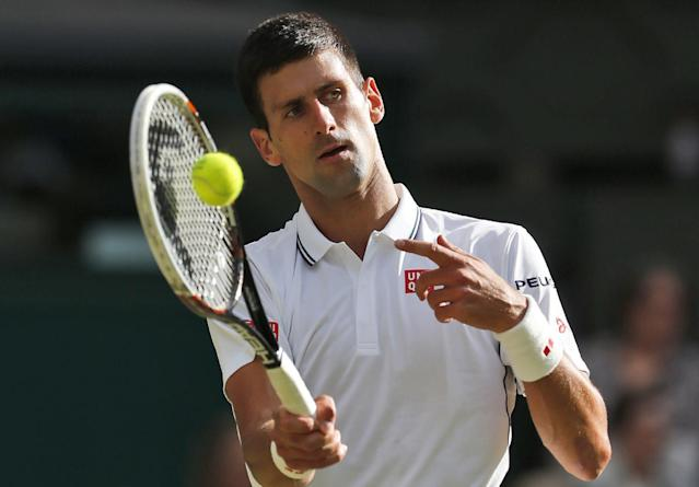 Novak Djokovic of Serbia prepares to serve to Radek Stepanek of the Czech Republic during their men's singles match at the All England Lawn Tennis Championships in Wimbledon, London, Wednesday, June 25, 2014. (AP Photo/Ben Curtis)