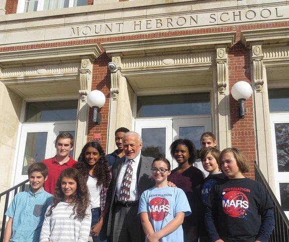 Apollo 11 moonwalker Buzz Aldrin poses with students on the stairs of the former Mount Hebron Middle School in Montclair, New Jersey, in October 2015. The school is being renamed the Buzz Aldrin Middle School,