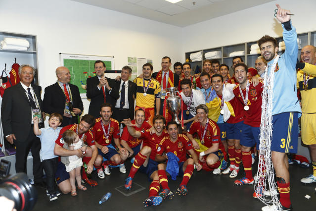 KIEV, UKRAINE - JULY 01: In this handout image supplied by the Royal Spanish Football Federation, Spanish president Mariano Rajoy and Prince Felipe of Spain celebrate with the victorious Spanish team in the dressing room after the UEFA EURO 2012 final match between Spain and Italy at the Olympic Stadium on July 1, 2012 in Kiev, Ukraine. (Photo by Carmelo Rubio / RFEF via Getty Images)
