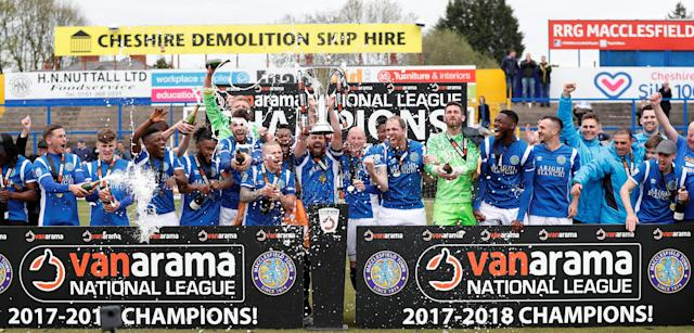 Soccer Football - National League - Macclesfield Town v Dagenham & Redbridge - Moss Rose, Macclesfield, Britain - April 28, 2018 Macclesfield Town players celebrate winning the National League with the trophy Action Images/Peter Cziborra
