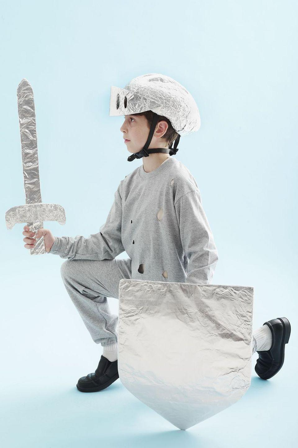 <p>Cover a DIY cardboard shield and sword as well as a bike helmet with tinfoil, and you're a knight of the Round Table.</p>