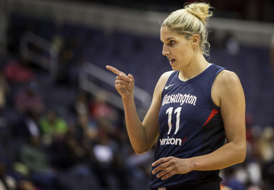 Elena Delle Donne points during a game.