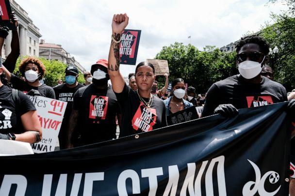 PHOTO: Natasha Cloud marches to the MLK Memorial to support Black Lives Matter and marking the end of slavery in the U.S., June 19, 2020, in Washington. (Michael A. Mccoy/Getty Images, FILE)