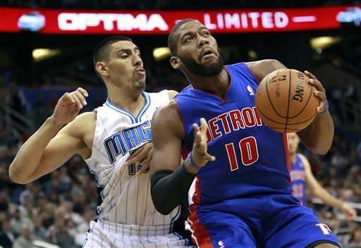 Detroit Pistons' Greg Monroe (10) makes a move to get around Orlando Magic's Gustavo Ayon, of Mexico, during the first half of an NBA basketball game, Wednesday, Nov. 21, 2012, in Orlando, Fla. (AP Photo/John Raoux)