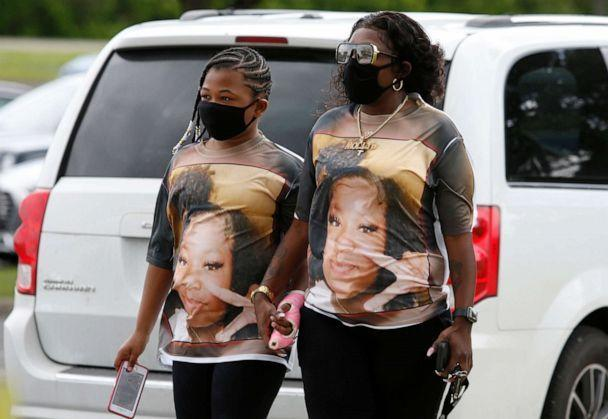PHOTO: Mourners wearing shirts with Ma'Khia Bryant's picture, arrive for the funeral for the 16-year-old at the First Church of God in Columbus, Ohio, April 30, 2021. (Paul Vernon/AP)