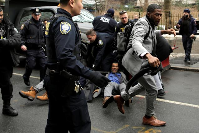 <p>New York City Council member Jumaane D. Williams, right, and City Councilmember Ydanis Rodriguez (on ground) clash with police during a demonstration by activists against deportation outside the Jacob Javits Federal Building in Manhattan in New York City, Jan. 11, 2018. (Photo: Eduardo Munoz/Reuters) </p>