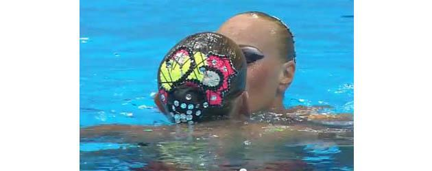 During their synchronized swimming finals routine, Ukrainians Daria Iushko and Kysenia Sydorenko shared this quick and surprising kiss.