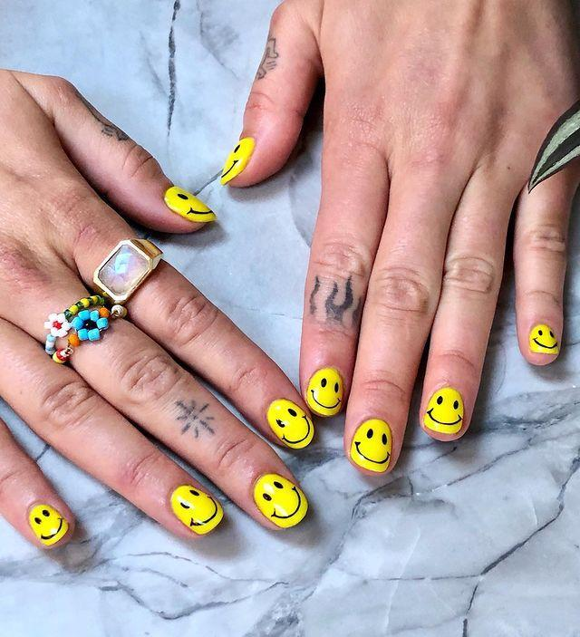 """<p>After months of social distancing, Dua Lipa has finally been reunited with her manicurist – and the resulting manicure is freaking sick. The singer went for a smiley face motif that is basically guaranteed to spark joy. </p><p><a href=""""https://www.instagram.com/p/CBiOJEwJpsz/"""" rel=""""nofollow noopener"""" target=""""_blank"""" data-ylk=""""slk:See the original post on Instagram"""" class=""""link rapid-noclick-resp"""">See the original post on Instagram</a></p>"""