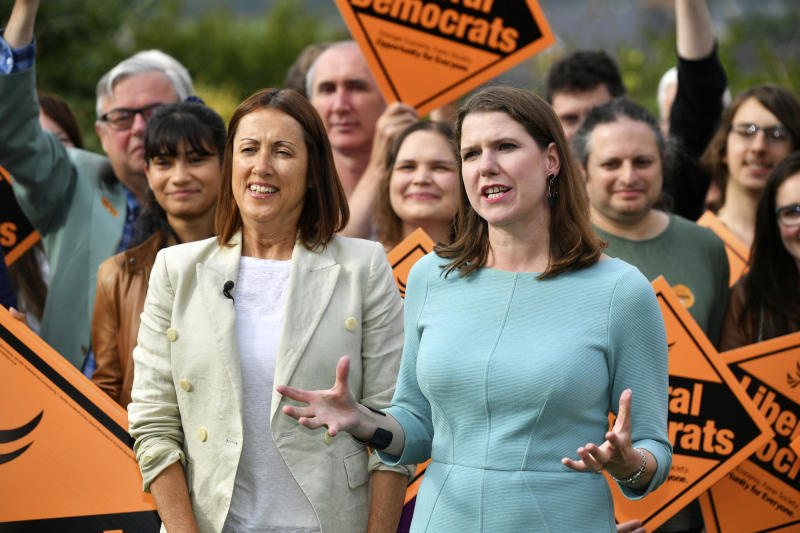 Newly-elected Liberal Democrat leader Jo Swinson, right, and Welsh Liberal Democrat leader Jane Dodds celebrate in Brecon, Wales, after the Liberal Democrats win the Brecon and Radnorshire by-election, Friday Aug. 2, 2019. In the Conservatives' first electoral test since Boris Johnson became prime minister nine days ago, the party was defeated for the seat of Brecon and Radnorshire in Wales by Jane Dodds of the opposition Liberal Democrats. (Ben Birchall/PA via AP)