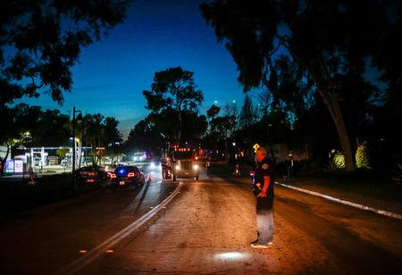 Vehicles are seen as a 6 P.M. mandatory evacuation order is placed after a mudslide in Montecito, California, U.S. January 11, 2018.  REUTERS/ Kyle Grillot