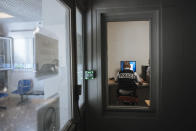 A police officer works in the police station of the Paris suburb of Sarcelles, Tuesday, June, 15, 2021. In the run-up to France's presidential elections in 2022, crime and policing are again becoming hot-button issues. Some political opponents of President Emmanuel Macron argue that France is becoming an increasingly violent country. (AP Photo/Lewis Joly)