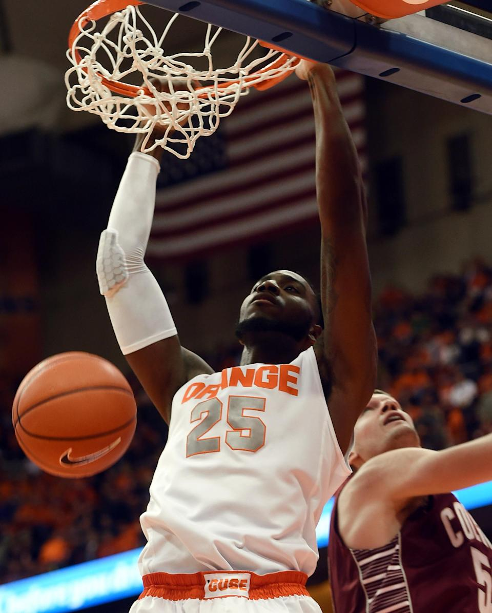 Syracuse's Rakeem Christmas dunks again Colgate's Ethan Jacobs during the first half of an NCAA college basketball game in Syracuse, N.Y., Monday, Dec. 22, 2014. (AP Photo/Kevin Rivoli)