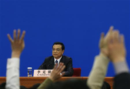 China's Premier Li Keqiang takes questions during a news conference, after the closing ceremony of the Chinese National People's Congress (NPC) at the Great Hall of the People, in Beijing March 13, 2014. REUTERS/Kim Kyung-Hoon