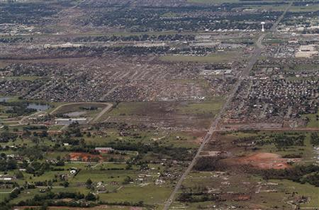 An aerial view of damage to neighborhoods in Moore, Oklahoma in this file photo from May 21, 2013, shows the path of destruction in the aftermath of a tornado which ravaged the suburb of Oklahoma City. REUTERS/Rick Wilking/Files